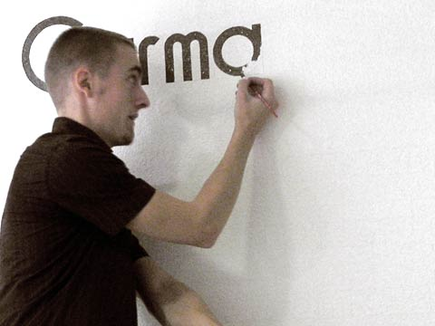 "I was hired to paint the definition of the word ""Carma"" (Karma) on the wall inside the café."